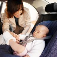 a child in a safety seat